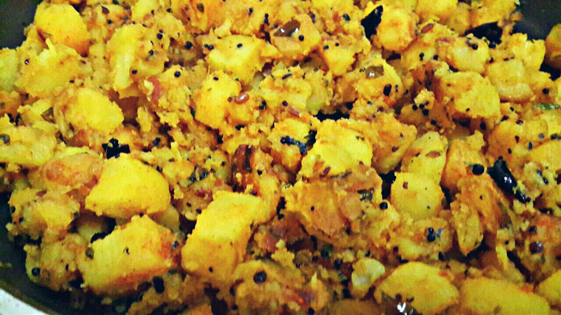 """""""Bagara Aaloo"""" or """"Tempered Potatoes""""! u just have to temper mustard seeds,cumin,dried red chilli, onions,some curry leaves n add d cut potatoes vit salt,redchilli powder,turmeric powder keep it for simmer in a little water...n its done...a very easy everyday recepie! Enjoy!^_^"""